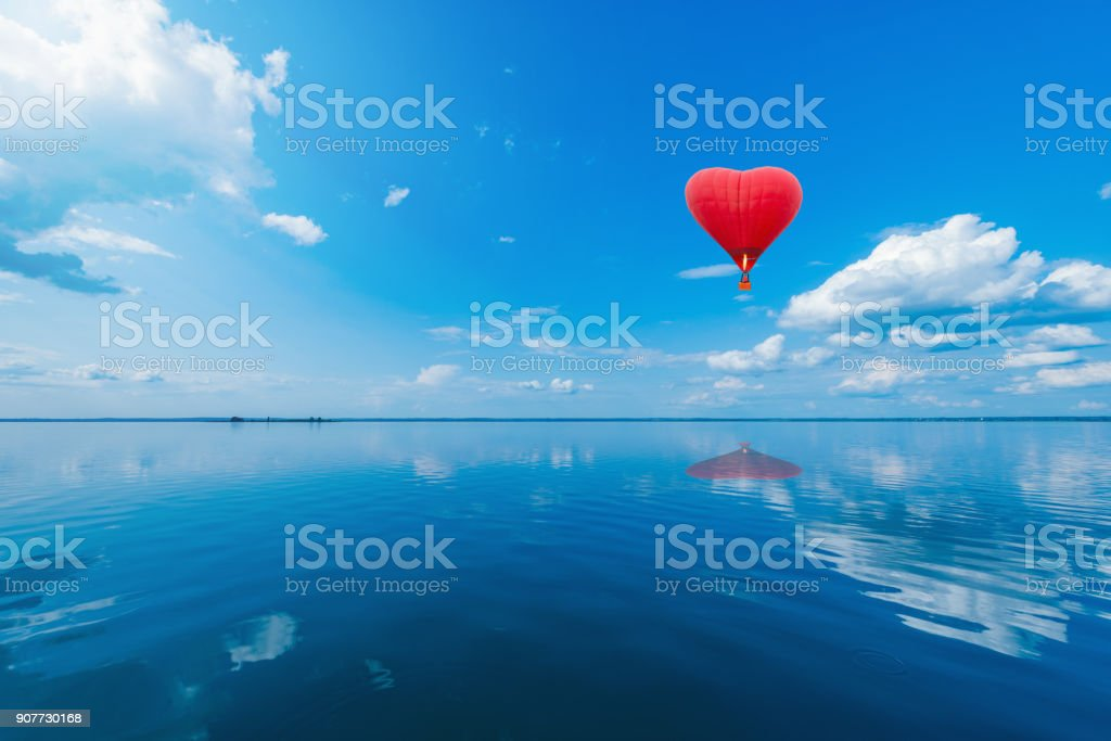 Red hot air balloon in the shape of a heart. stock photo