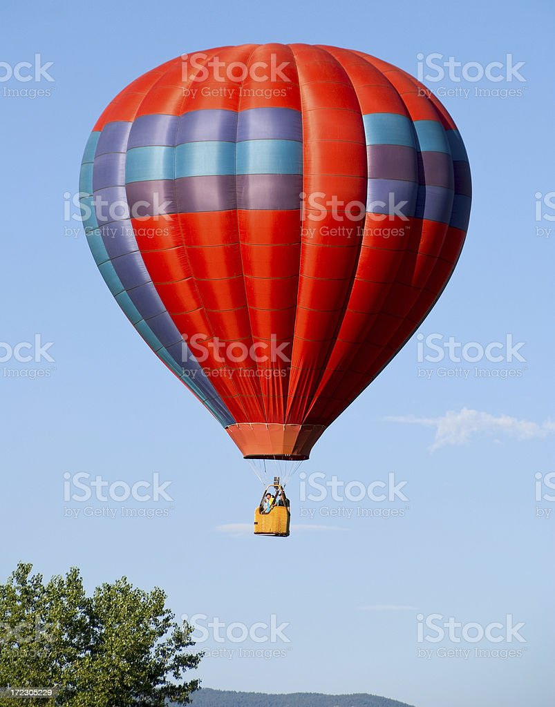 Red Hot Air Balloon on Blue Sky 2 royalty-free stock photo