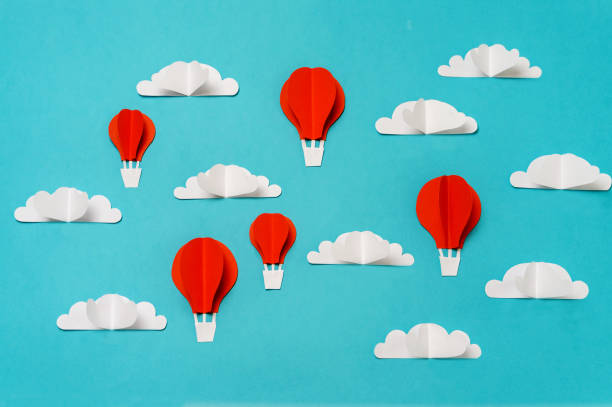 Red hot air balloons in sky paper cut and origami objects. Creative concept for banner/landing/background designs. stock photo