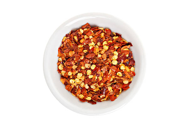red hot chili pepper seeds and flakes - rode chilipeper stockfoto's en -beelden