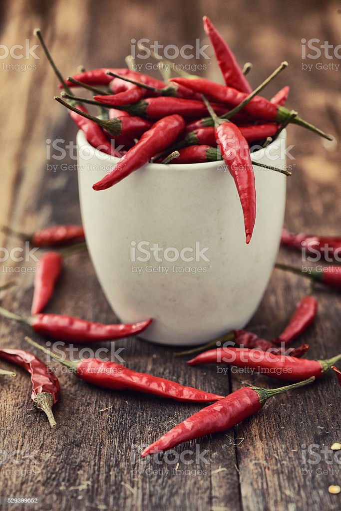 Red hot chili peppers in a white cup stock photo