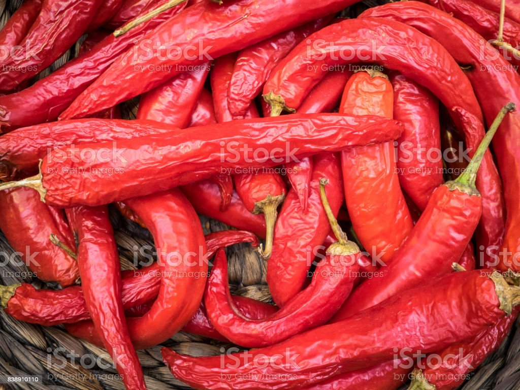 Red hot chili peppers on a wicker basket stock photo