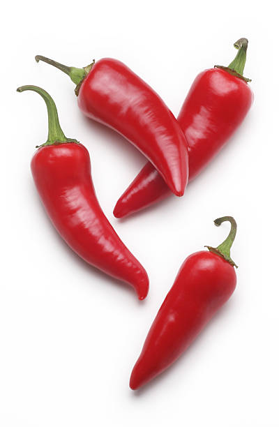 red hot chili peppers - red bell pepper isolated imagens e fotografias de stock