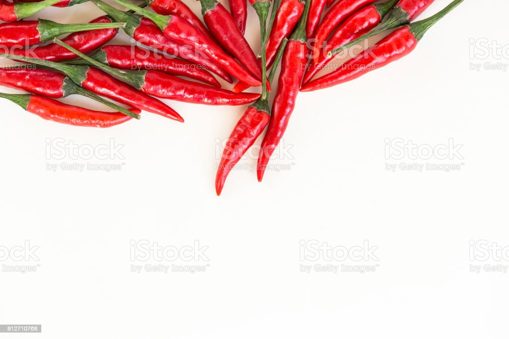 red hot chili peppers, popular spices concept - small handful of red hot pepper in bulk, isolated on white background, top view, flat lay, lot of free space for your text stock photo