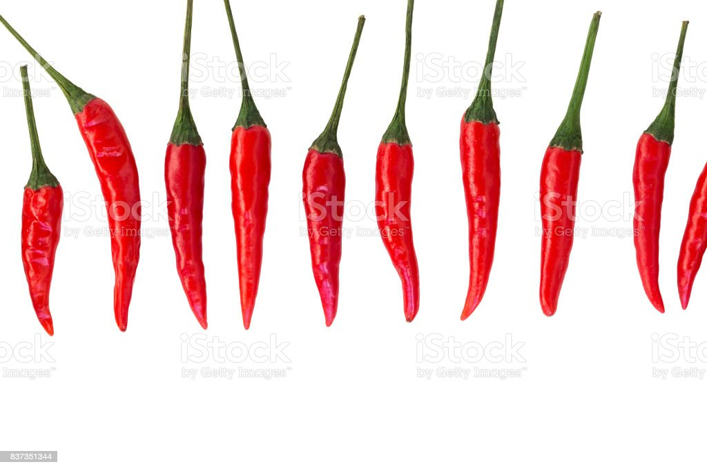 red hot chili peppers, popular spices concept - vertically stacked row of pods of the red hot chili peppers on a white background, top view, flat lay, free space for your text stock photo