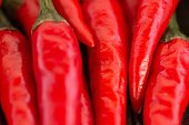 istock red hot chili peppers, popular spices concept - very tasty macro of red fresh chili peppers, pretty clean juicy pods with green tails, top view, flat lay 675244124