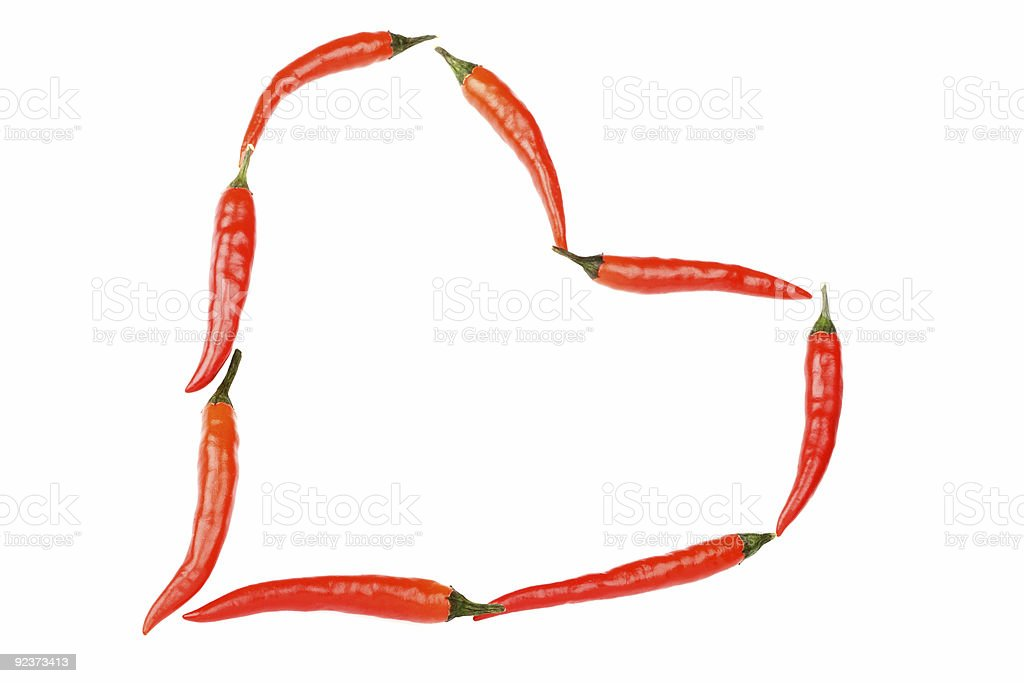 red hot chilli peppers in heart shape royalty-free stock photo