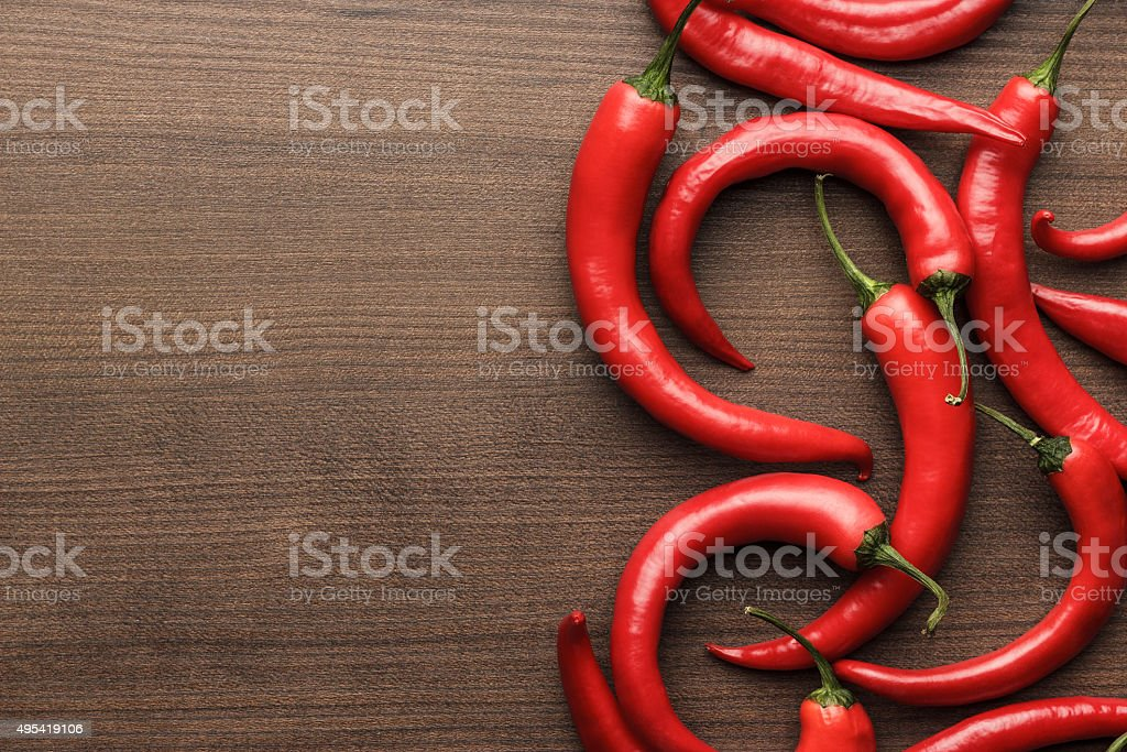 red hot chilli peppers on wooden table stock photo
