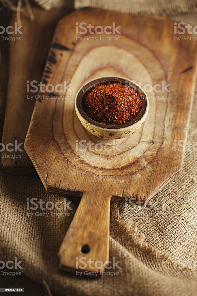 red hot chillies pepper  flakes in bowl on wood royalty-free stock photo