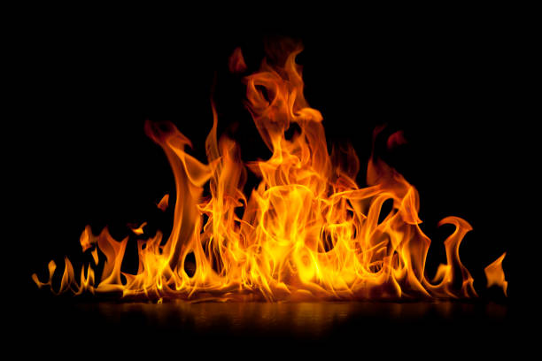 Red hot flames of fire isolated on black stock photo