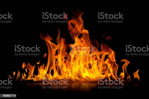 Photo of Red hot flames of fire isolated on black