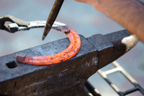 1130936245 istock photo red hot horseshoe on the anvil 176007211