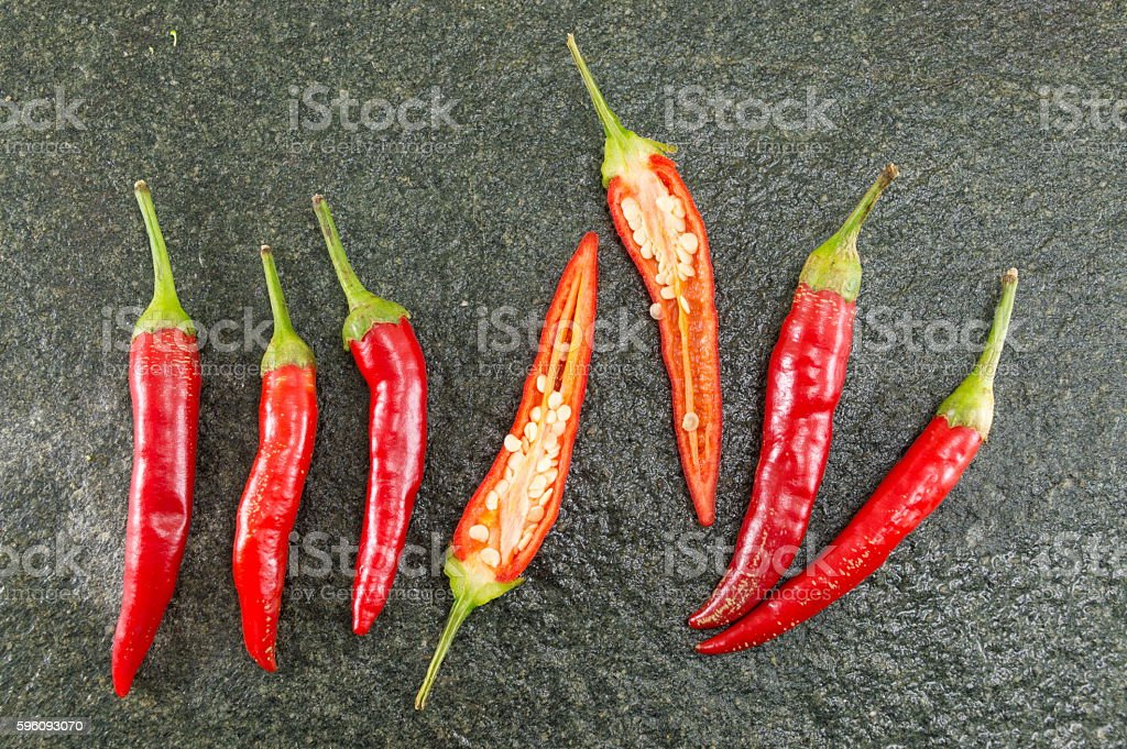 Red hot peppers on stone background royalty-free stock photo
