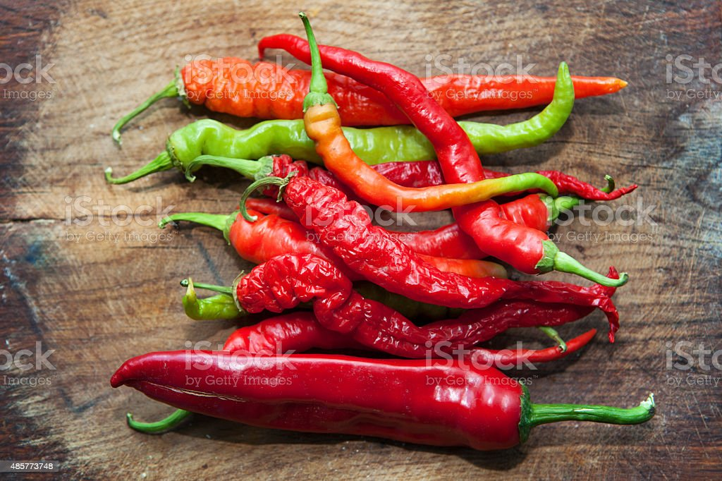 Red Hot Peppers Red  Peppers on the wooden table 2015 Stock Photo