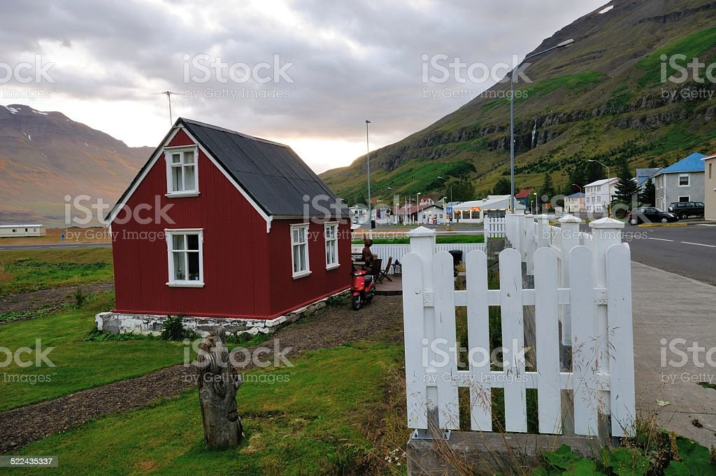 Red house in seydisfjordur stock photo