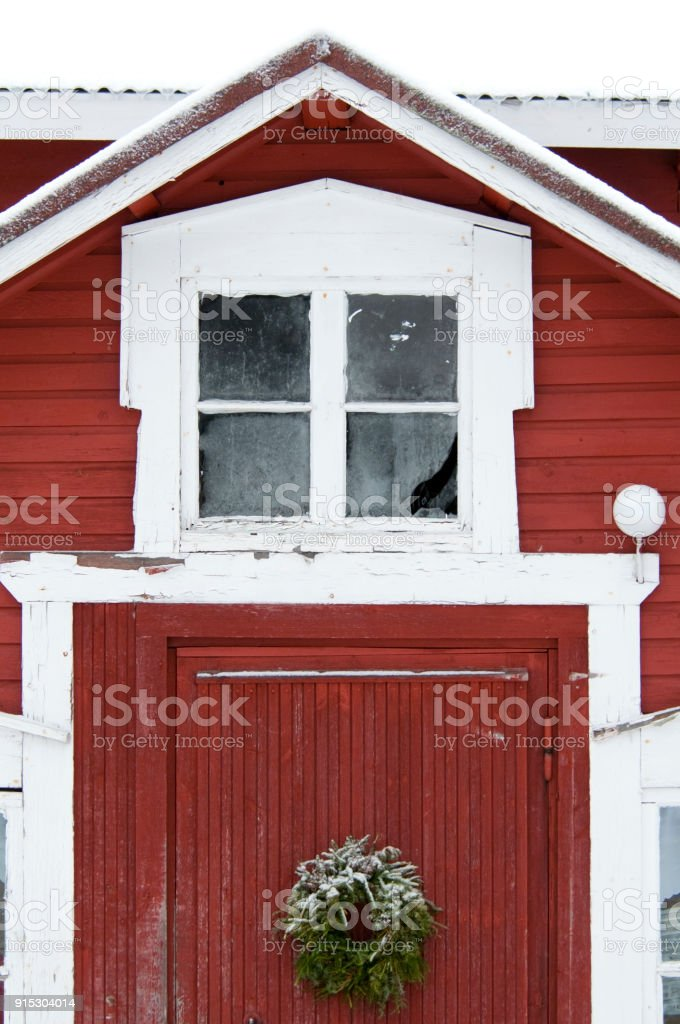 red house in snow Finland stock photo