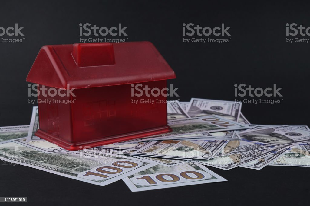 Red House Money Bank with dollar stock photo