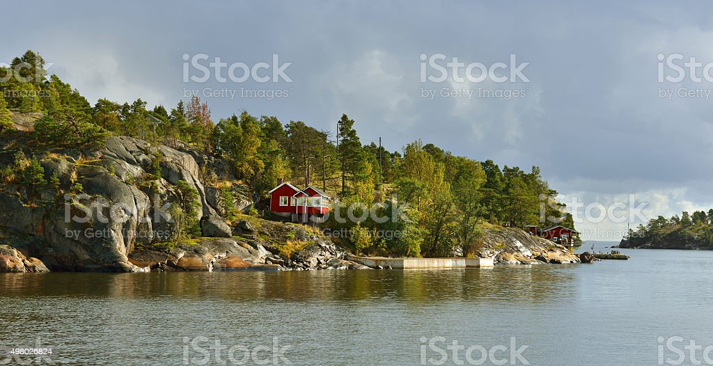 Red house on a rocky island. Helsinki stock photo