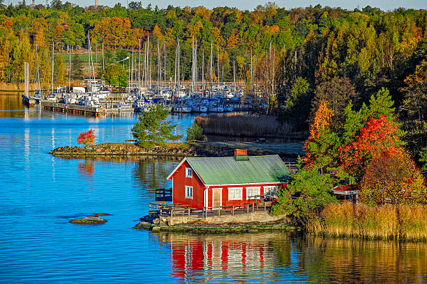 red house on rocky shore of ruissalo island, finland - finland stock pictures, royalty-free photos & images