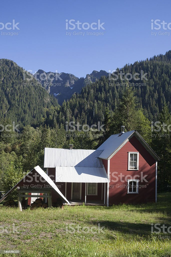 Red House with Mountains in the Background royalty-free stock photo