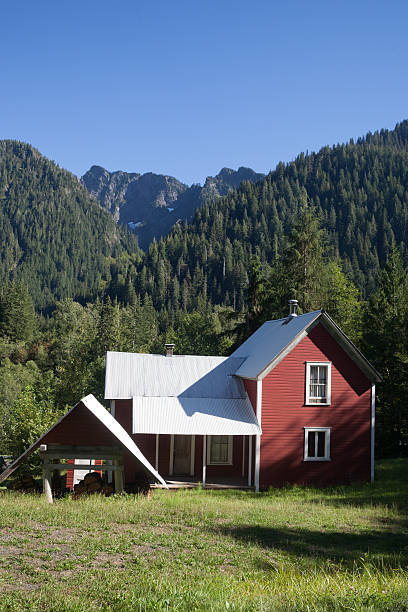 Red House with Mountains in the Background stock photo