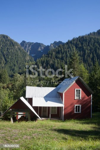Red House With Mountains In The Background Stock Photo & More Pictures of Cascade Range
