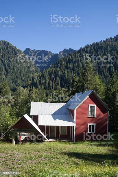 Red House With Mountains In The Background Stock Photo - Download Image Now