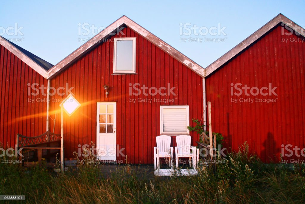 Red houses in the sunset royalty-free stock photo