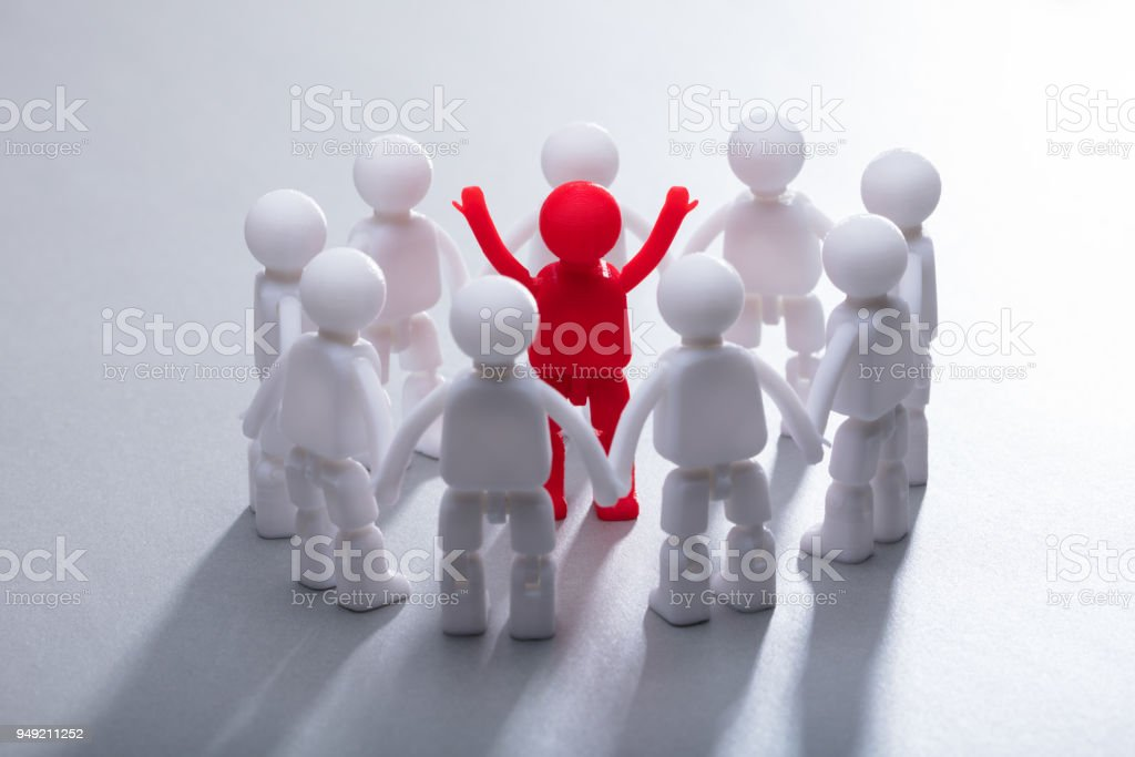 Red Human Figure Surrounded By Team stock photo