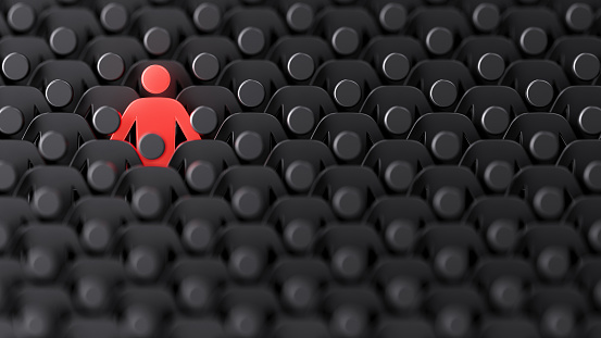 Red human shape among dark ones. Standing out of crowd concept