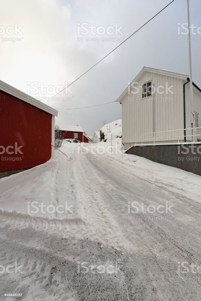 Red huts-rorbuer and modern white cottages-heavy snowfall. Hamnoy village-Reine-Moskenesoya-Nordland-Norway. 0382 stock photo