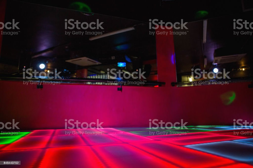 Red illuminated disco dance floor stock photo