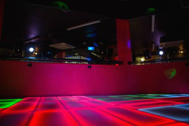 red illuminated disco dance floor - dance floor stock photos and pictures