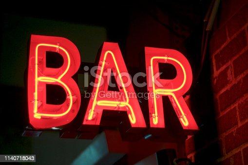 1140718043 istock photo Red illuminated neon BAR sign 1140718043