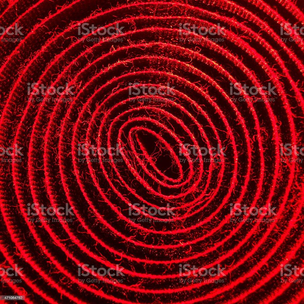 red illuminated spiral of velcro band stock photo