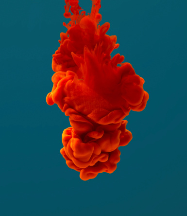 red ink dissolving in water