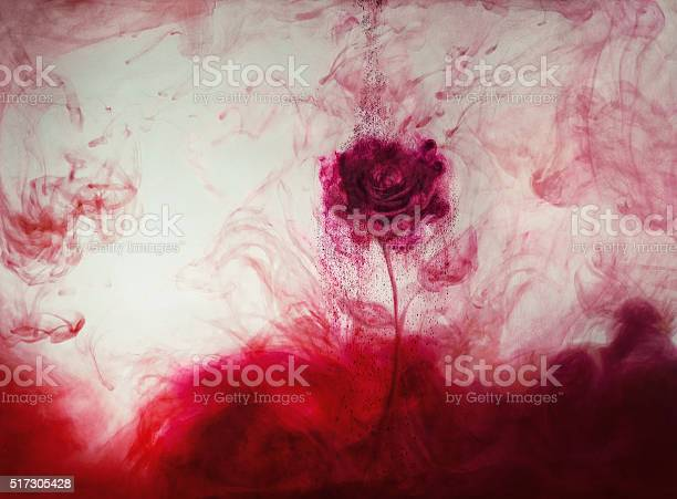 Photo of red ink rose out of ink
