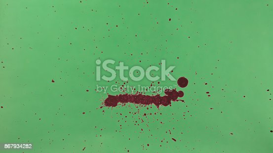 istock Red Ink Splatter Over Green Screen Background 867934282