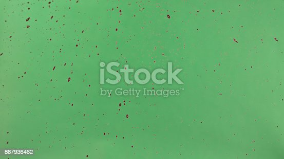 istock Red Ink Sprinkled Over Green Screen Background 867936462