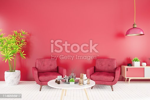Interior with armchair, coffee table and red wall