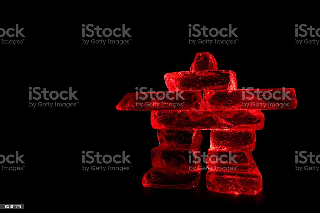 Red Inukshuk on Black Background royalty-free stock photo