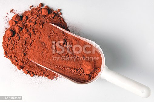 Red iron oxide pigment on white background