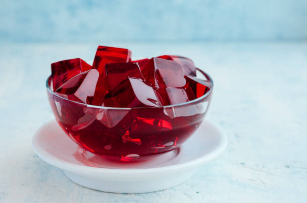 Red Jelly Cubes Cubes of red jelly in a glass bowl gelatin stock pictures, royalty-free photos & images