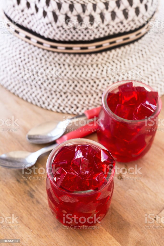 red jelly, cut into dice, inside two glasses of glass stock photo