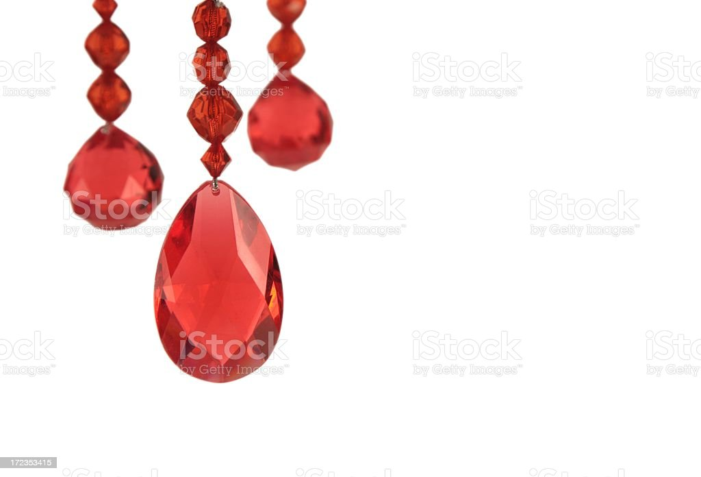 Red Jewel Ornaments dangling against white background royalty-free stock photo