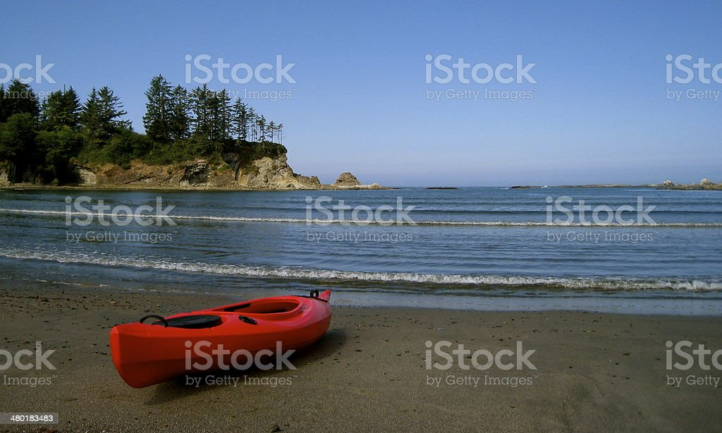 Red Kayak on Oregon Beach stock photo