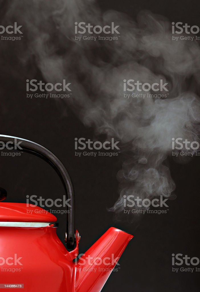 Red kettle steaming hot stock photo