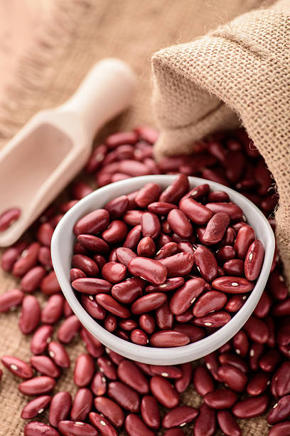 Red Kidney beans or redbeans in white ceramic bowl stock photo