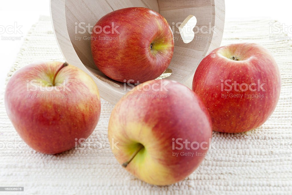 Red Kiku Apples and Wooden Basket with Hearts royalty-free stock photo