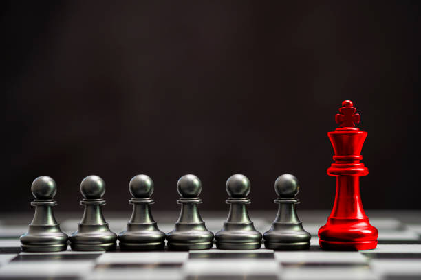 Red king chess with others black pawn chess for leader and different thinking.Disrupt concept. Red king chess with others black pawn chess for leader and different thinking.Disrupt concept. individual event stock pictures, royalty-free photos & images